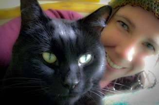 Hélène Clarke, author of 'Why Did the Osprey Poop on My Head?' and her cat Boo. (self-protrait).