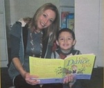"Victoria E. Ames reading ""I CAN DANCE TOO!"" with one of her students."