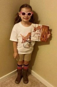 Barbara's granddaughter, a big fan of Little Miss History, dresses up as her favorite character.